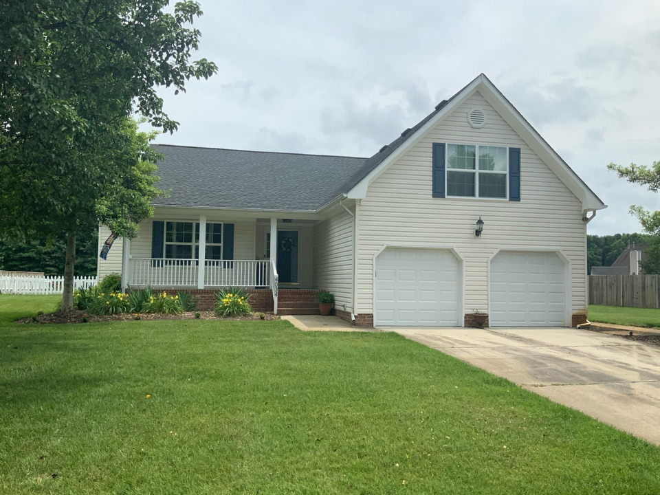 Suffolk, VA - Measuring a house to install new white PVC vinyl trim and soffit