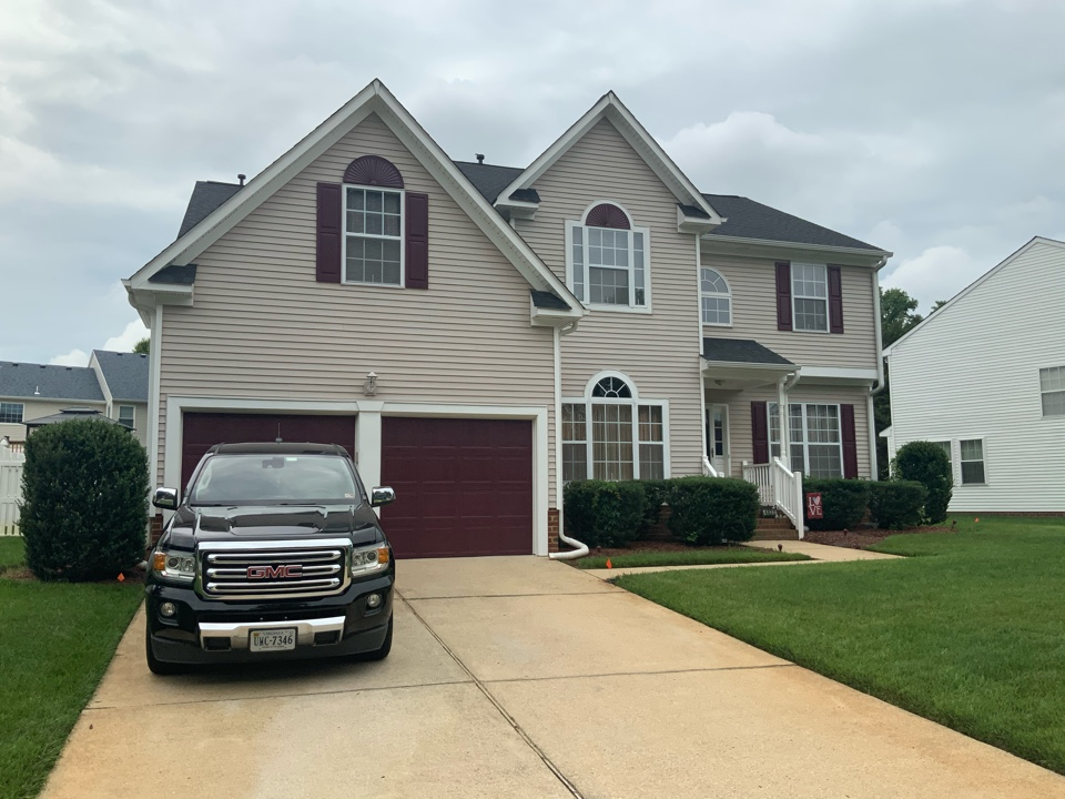 Portsmouth, VA - Measuring a house to install all new siding and trim and soffit