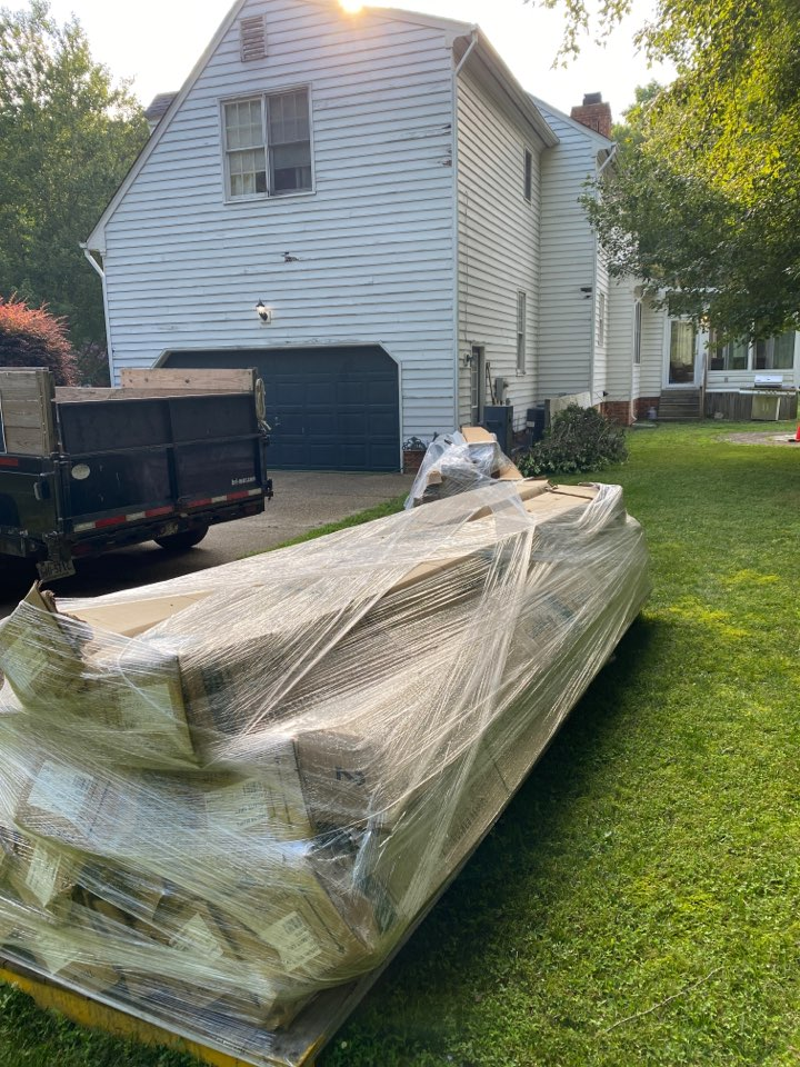 Smithfield, VA - Beginning this 35 square siding replacement project in Smithfield today using Cetainteed Granite Gray vinyl siding.