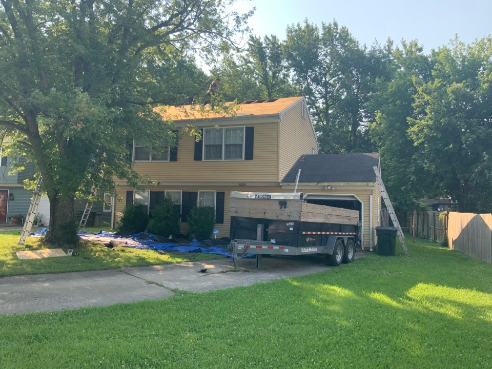 Hampton, VA - Removing the old shingles from the house in preparation to install new shingles