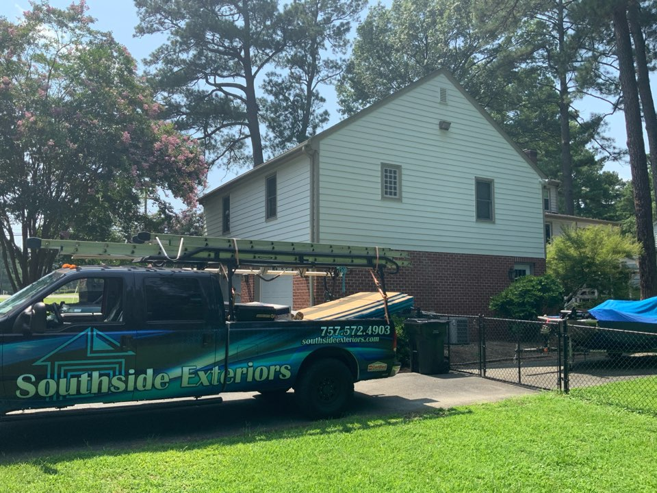 Franklin, VA - Measuring a house to install white vinyl Dutch lap siding
