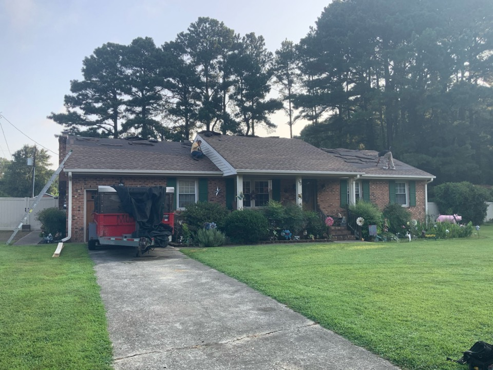 Smithfield, VA - Removing the old shingles in preparation to install new architectural shingles
