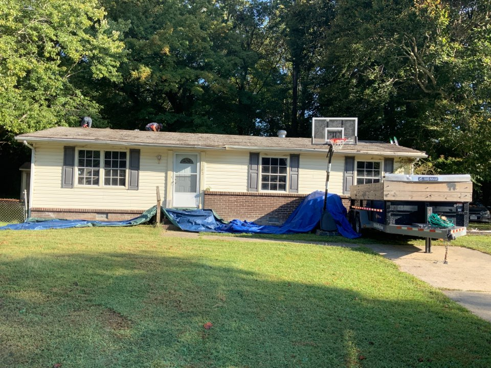Suffolk, VA - Removing a roof with two layers in preparation to install a new roof