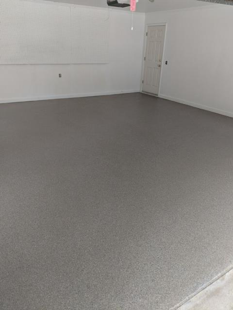 Marietta, GA - Another dingy garage floor upgraded by Guardian Garage Floors.  We don't use epoxy as it never lasts.