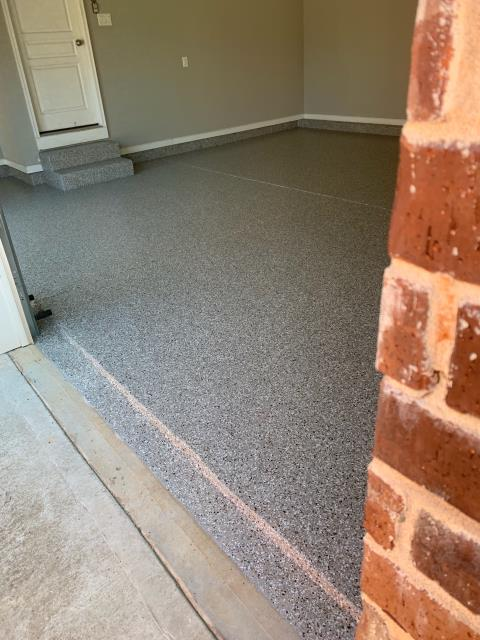 Marietta, GA - Guardian Garage Floors took this dingy garage floor and made it a usable clean space.  Our floors are warrantied for Life.  Call Guardian Garage Floors today!