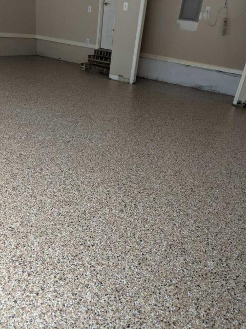 Marietta, GA - Another garage floor upgraded by Guardian Garage Floors.  Do not use epoxy, it will fail overtime.  Call us today for a free estimate and product demonstration.