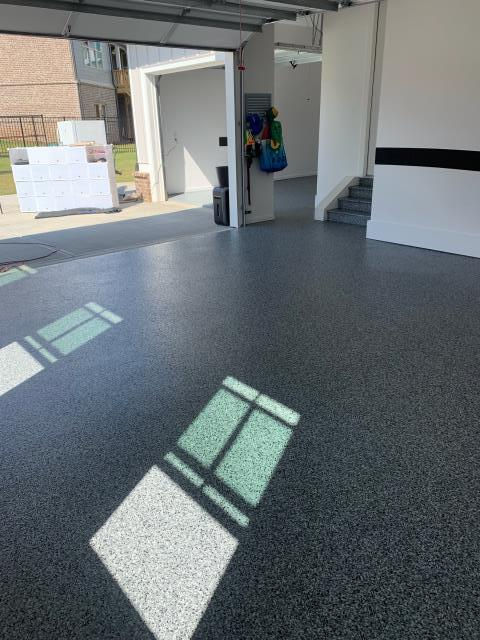 Marietta, GA - Guardian Garage Floors installs another beautiful garage floor for this customer in Marietta.  No epoxy used here, we use something 20 times stronger.  Call today for a free estimate!