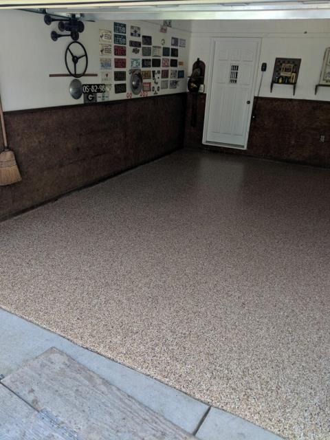 Roswell, GA - Ground down this dingy garage floor today and coated with polyaspartic.