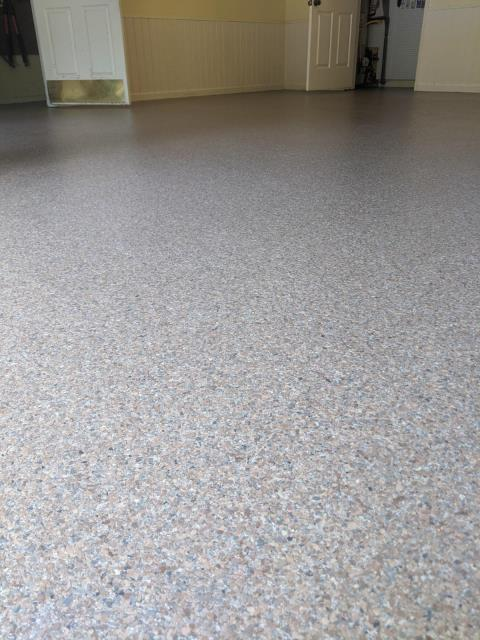 Marietta, GA - A beautiful garage floor coating is being installed in Marietta today. Our polyaspartic concrete coating is a lifelong flooring solution that comes with a lifetime warranty. This installation was done I the color Garnet Gray.