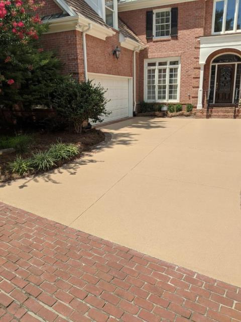 Roswell, GA - An excited customer in Roswell got a new Guardian garage floor coating for their driveway.