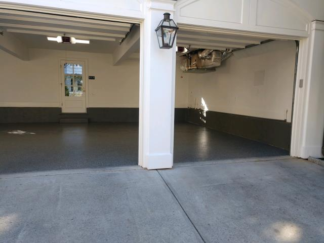 Atlanta, GA - Guardian Garage Floors did a gorgeous garage makeover in Atlanta today. We replaced a peeling epoxy floor with our stronger polyaspartic concrete coating. This install in the color Gun metal will now last a lifetime.