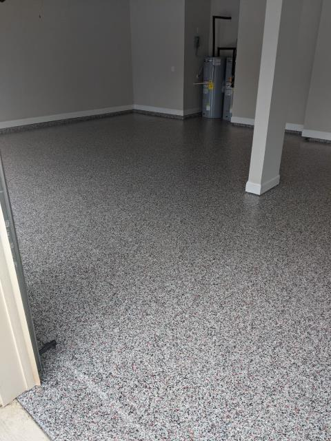 Marietta, GA - Installing a failing epoxy concrete floor coating to install a polyaspartic concrete floor coating with a lifetime warranty in Marietta GA. This install was done in our color Domino/Red.