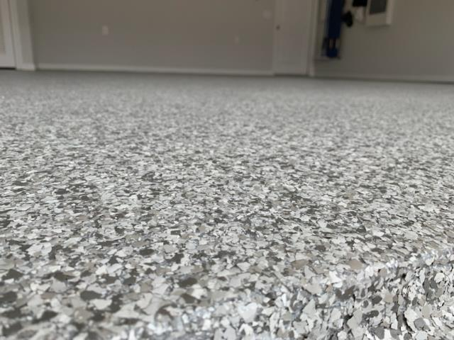 Marietta, GA - Guardian Garage Floors is removing a peeling epoxy and paint concrete floor coating to install our polyaspartic concrete floor coating with a lifetime warranty in Marietta GA. This install is in our color Dovetail.
