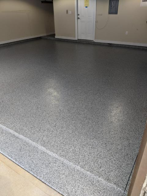 Atlanta, GA - Removing an epoxy concrete floor that failed and installing a strong Guardian Garage Floors' concrete coating today in Brookhaven GA. This install was done in our color 1/8 Domino.