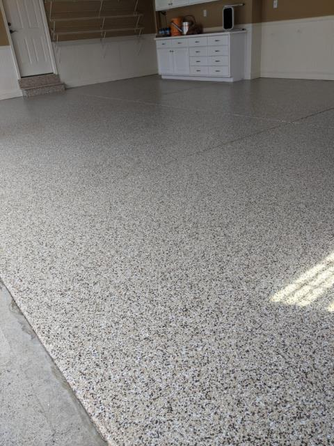 Marietta, GA - Installing a low maintenance, UV resistant concrete floor coating that will not fade from the sun like epoxy concrete floor coatings in Marietta GA. This install was done in our color Buckskin.