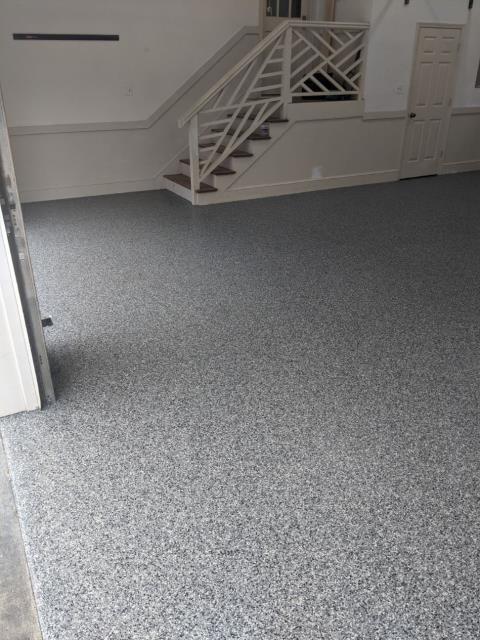 Atlanta, GA - Removing a failing DIY paint floor coating to install a long lasting polyaspartic floor coating in Atlanta GA in the color Gunmetal.