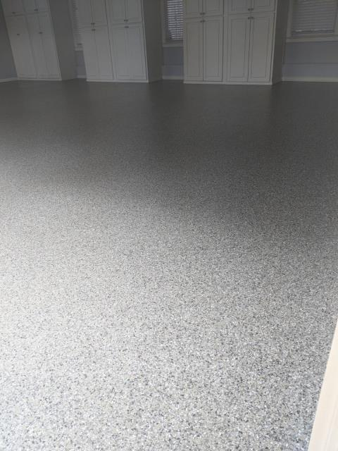Marietta, GA - Installing a strong and long lasting garage concrete floor coating in Marietta GA that will not peel like epoxy concrete floor coatings. This install was for a large there car garage in the color Crossbow.