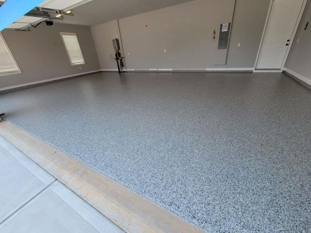 Marietta, GA - Installing this beautiful concrete coating for a three car garage in Marietta GA. Guardian Garage Floors did a great job with this installation in the color Crossbow.