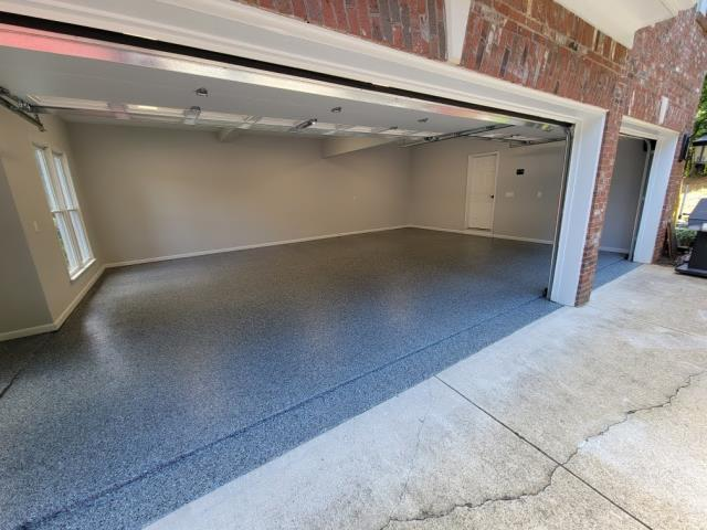 Woodstock, GA - Guardian Garage Floors helped another customer in Woodstock GA  get a new polyaspartic concrete coating for their three car garage. This install was done in our popular color Gunmetal.