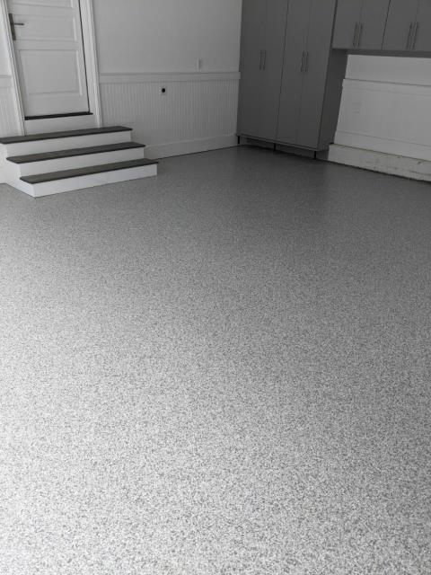 Atlanta, GA - Guardian Garage Floors is installing a garage concrete floor coating that will not peel or fade like epoxy floor coatings for a large four car garage in Alpharetta GA. This install was done in our neutral color Dovetail making their cabinetry pop.