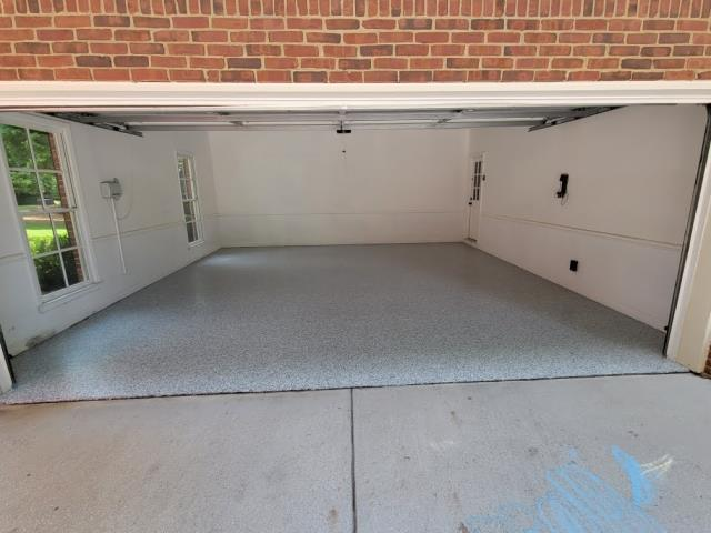Cumming, GA - Installing a strong and durable garage concrete floor coating that will last longer than epoxy concrete floor coatings in Cumming GA. This install was done in our color seamist.