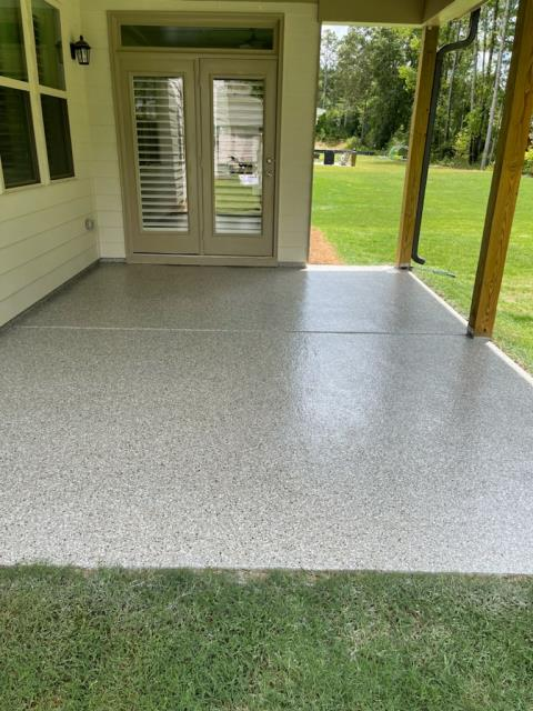 Marietta, GA - Installing a low maintenance, UV resistant back patio concrete floor coating that will not fade from the sun like epoxy concrete floor coatings would. This install was done in our color creekbed in Marietta Ga.