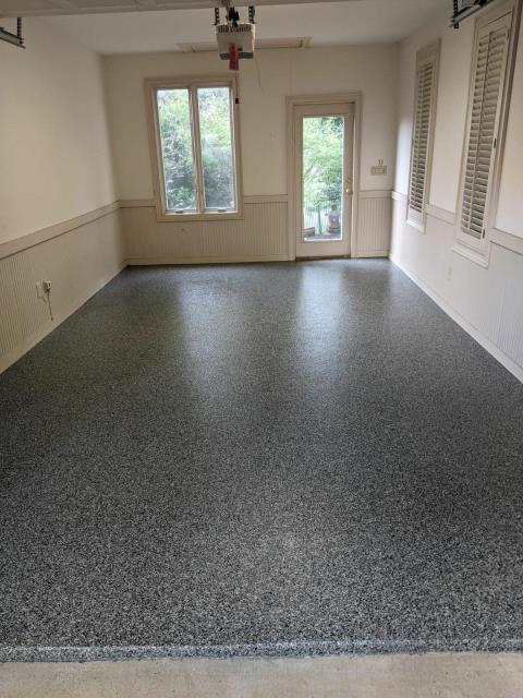 Marietta, GA - Another customer in Marietta GA is excited about getting their new Polyaspartic floor coating in the color Gun metal. Now the floor is guaranteed not to chip or peel for a lifetime.