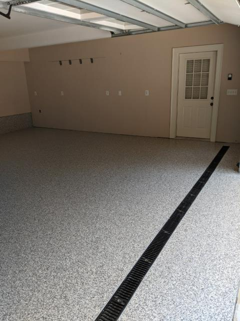 Atlanta, GA - An excited customer in Atlanta GA transformed their garage with our polyaspartic coating in the color mushroom. Now their floor will hold up for a lifetime.