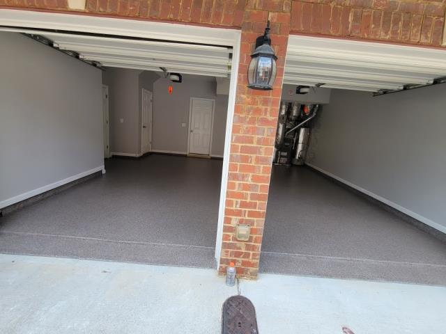 Atlanta, GA - The color Garnett looks amazing in this two car garage in Atlanta GA. Now this customers has stain and UV resistant floors thanks to Guardian Garage.