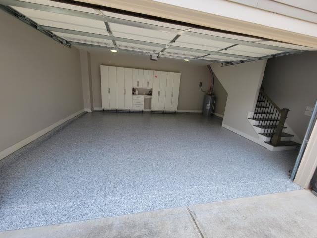 Marietta, GA - Guardian Garage Floors is in Marietta GA installing this stain resistant floor in the color Gravel. Our polyaspartic concrete coating will last a lifetime for this customer.