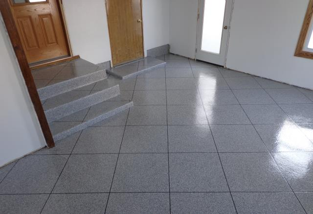"Dayton, OH - This floor made me ""wow"" out loud when I saw it! Just an outstanding job done! From the top of the stairs, all along the doorways, and down the sides of the walls, it looks spectacular! I don't think I have ever seen a decorative concrete coating that looks this good! Elsner Painting is the number one go-to choice!"