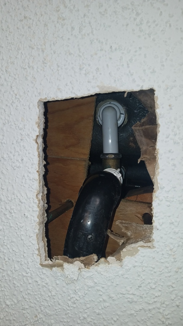 Repaired a leaking tub and shower drain from kitchen ceiling area below in the east Cobb area.