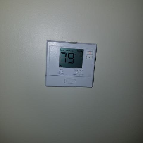 McDonough, GA - Replaced residential heat pump thermostat.