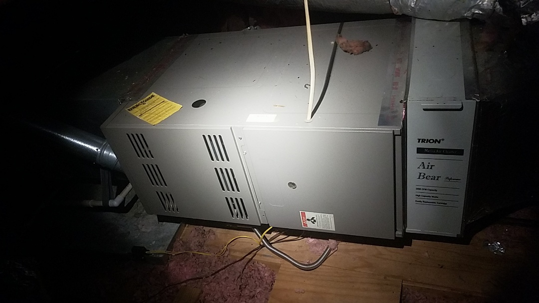 Peachtree City, GA - Working on a gas furnace with a high-efficiency filter