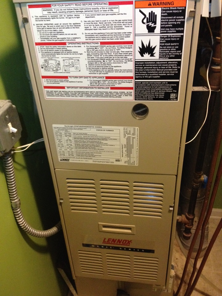 Maple Grove, MN - Service on a Lennox furnace.  Replacing flame sensor, humidifier pad, and filter
