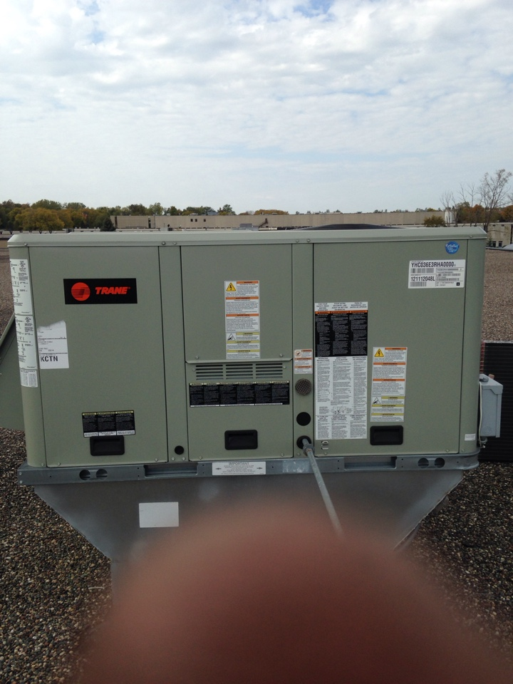 Plymouth, MN - Installing a new condenser coil  in a Trane rooftop unit.