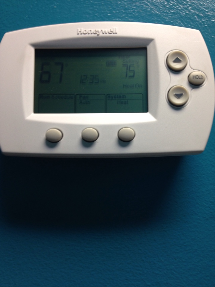 Crystal, MN - Service on a Lennox roof top unit, and thermostat. Replaced old mercury thermostat with a Honeywell 6000 programmable thermostat.