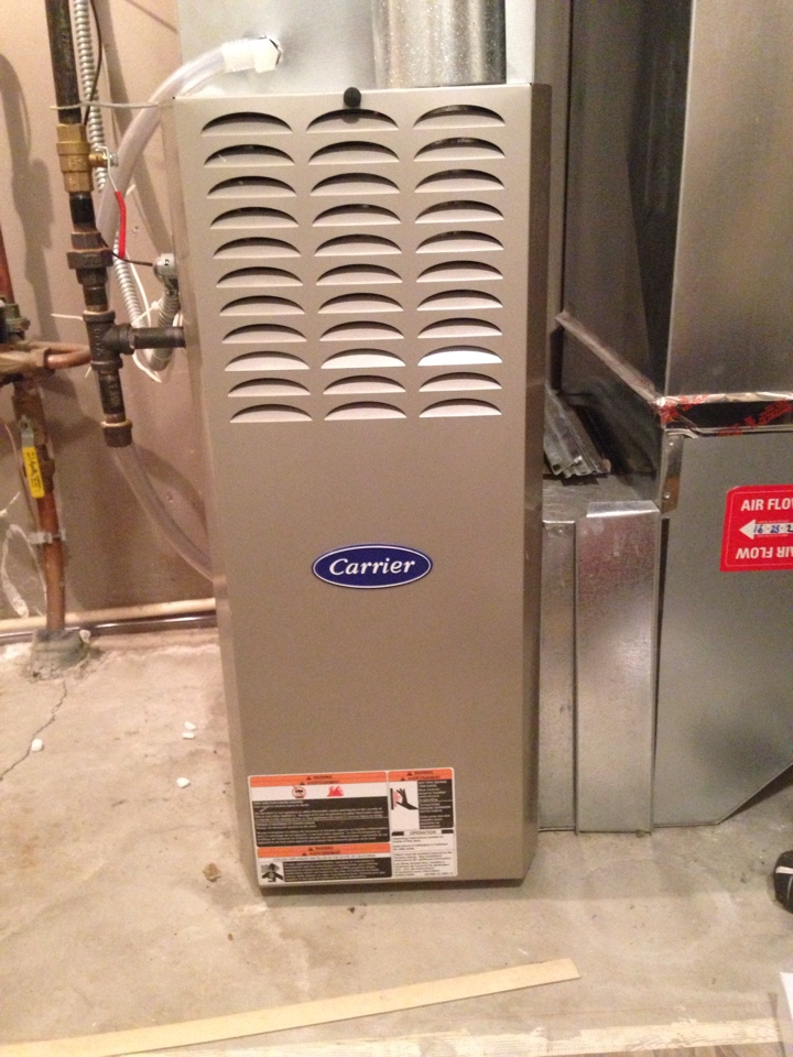Shakopee, MN - Tuneup in a Carrier 80% efficient furnace. Replace blower capacitor. Install NSI low level CO detector.