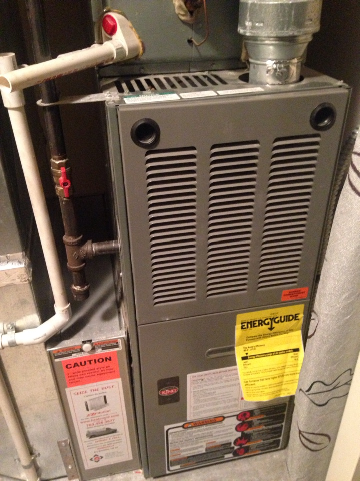 Elk River, MN - Service in a Honeywell thermostat, replacing batteries.