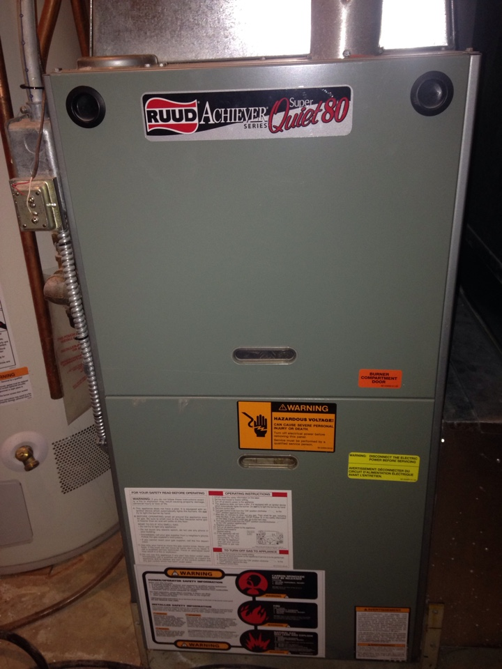 Maintenance on a Ruud furnace.