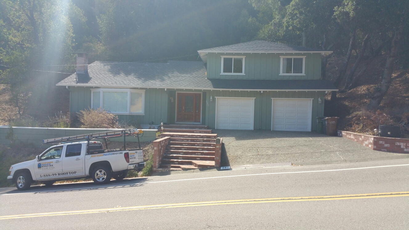 Fairfax, CA - Certainteed Landmark TL moire black composition shingles on this beautiful house in Fairfax.