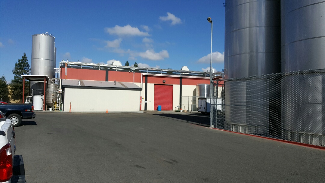 Petaluma, CA - We built new curbs and installed new exhaust fans on the bottling plant at Lagunitas Brewery. Water tight!!