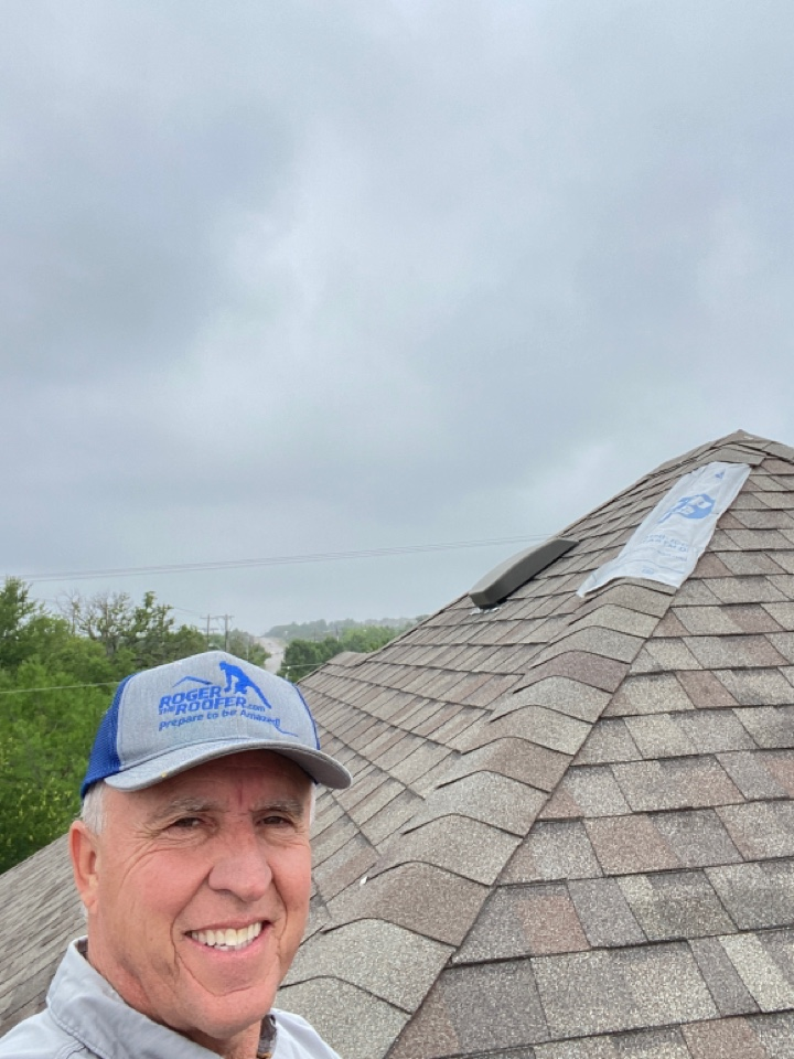 Keller, TX - Just had to come up here and put a temporary patch on this Ridge till we can get some shingles up here as it's starting to sprinkle right now this will be a easy fix for this customer… Got a love the roofing business