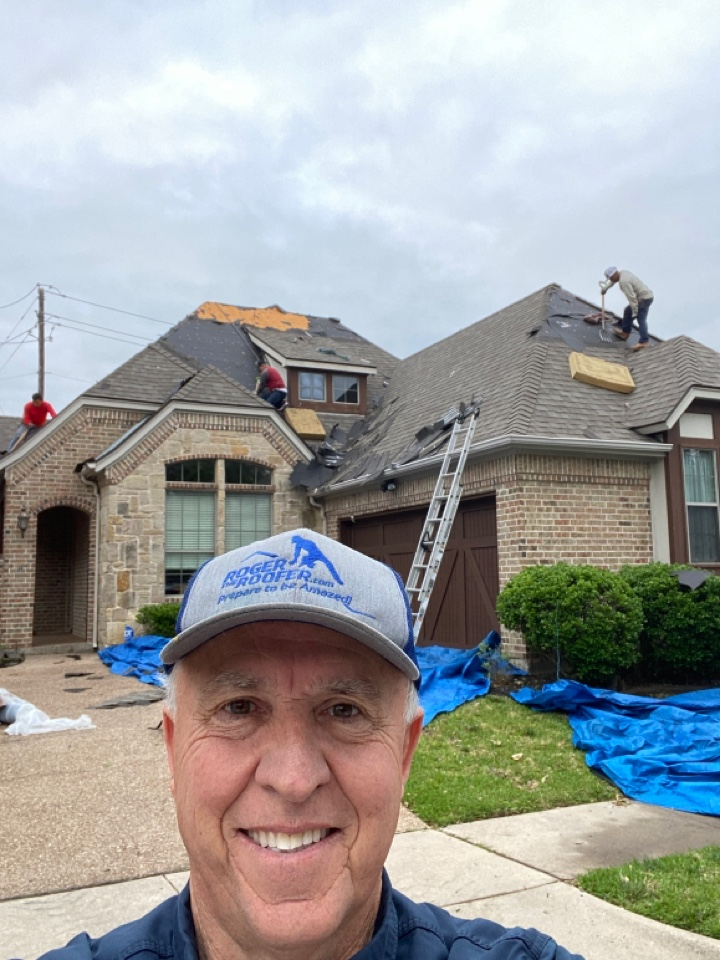 Keller, TX - Keller Texas, we were able to get the insurance company to pay for roof gutters windows paint damage etc.… In the picture you'll notice that were using ropes so that the guys feel safe on the roof… Early mornings in the roofing business are amazing