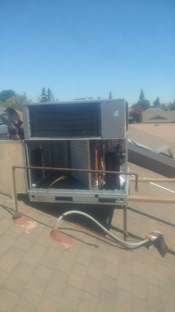 Lodi, CA - Switching an old Day and Night package unit on the roof for a new Bryant unit