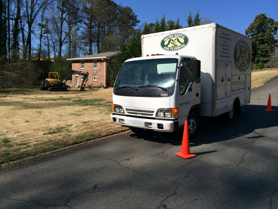 Marietta, GA - Septic to sewer conversion. Tank has excessive grease trapped inside