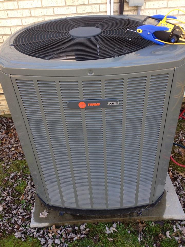 Loretto, TN - Performing maintenance on a Trane heat pump.