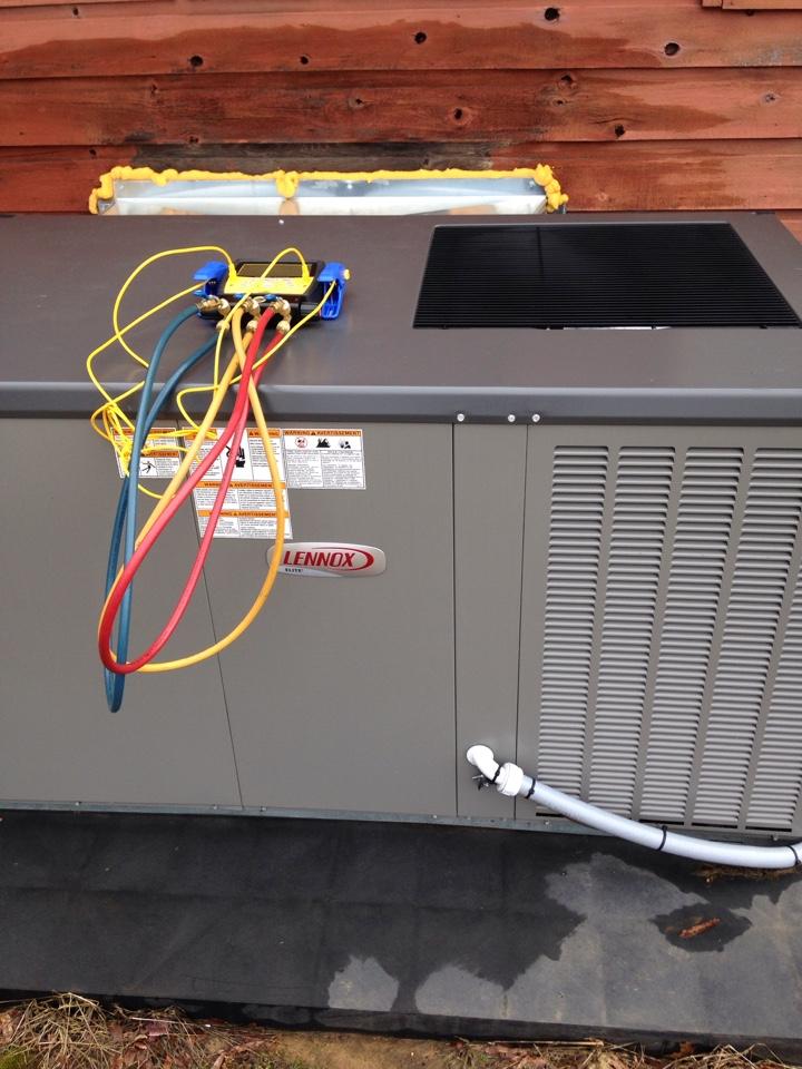 Moulton, AL - Performing maintenance on a Lennox Package Heat Pump.