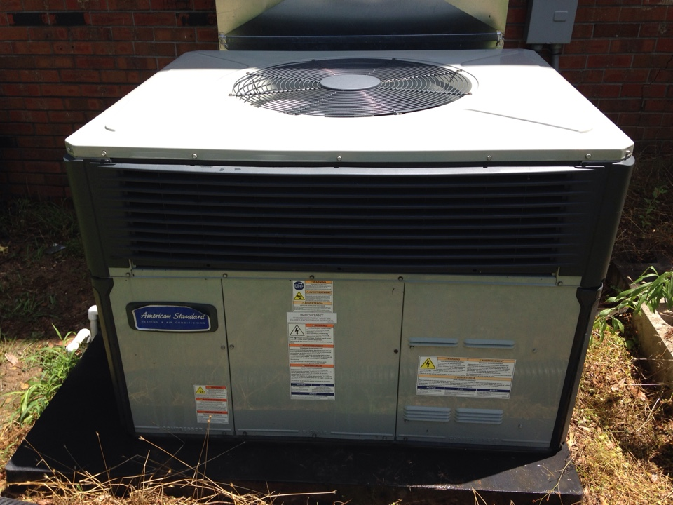 Phil Campbell, AL - Performing maintenance on an American Standard Package Heat Pump.