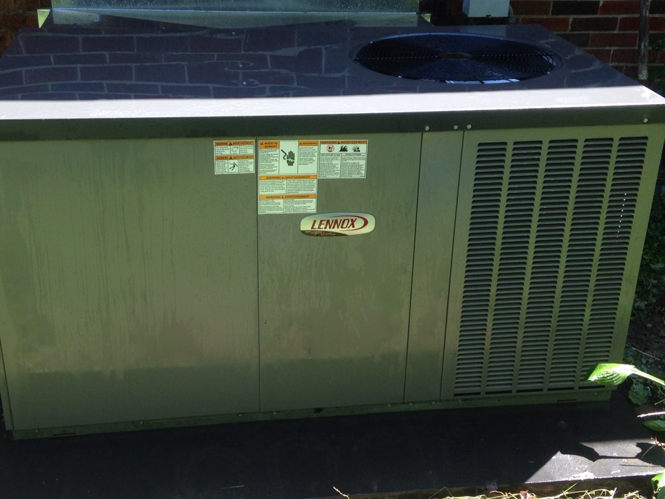 Anderson, AL - Performing maintenance on a Lennox Package Heat Pump.